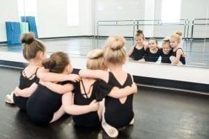ballet dancers looking in mirror