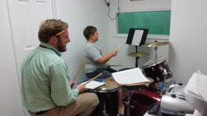 Mr. Chris with drum student