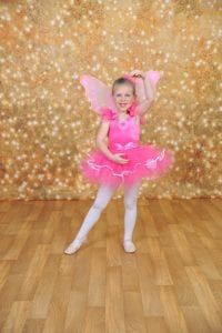 girl in butterfly ballet outfit
