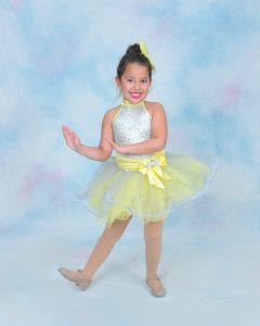 Young ballet dancer in yellow