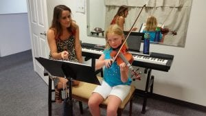 miss erica with violin student