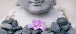 flower and buddha statue